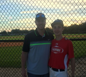 Roy with his son Braden at this year's All-America Pre-Season Rookie Tournament.