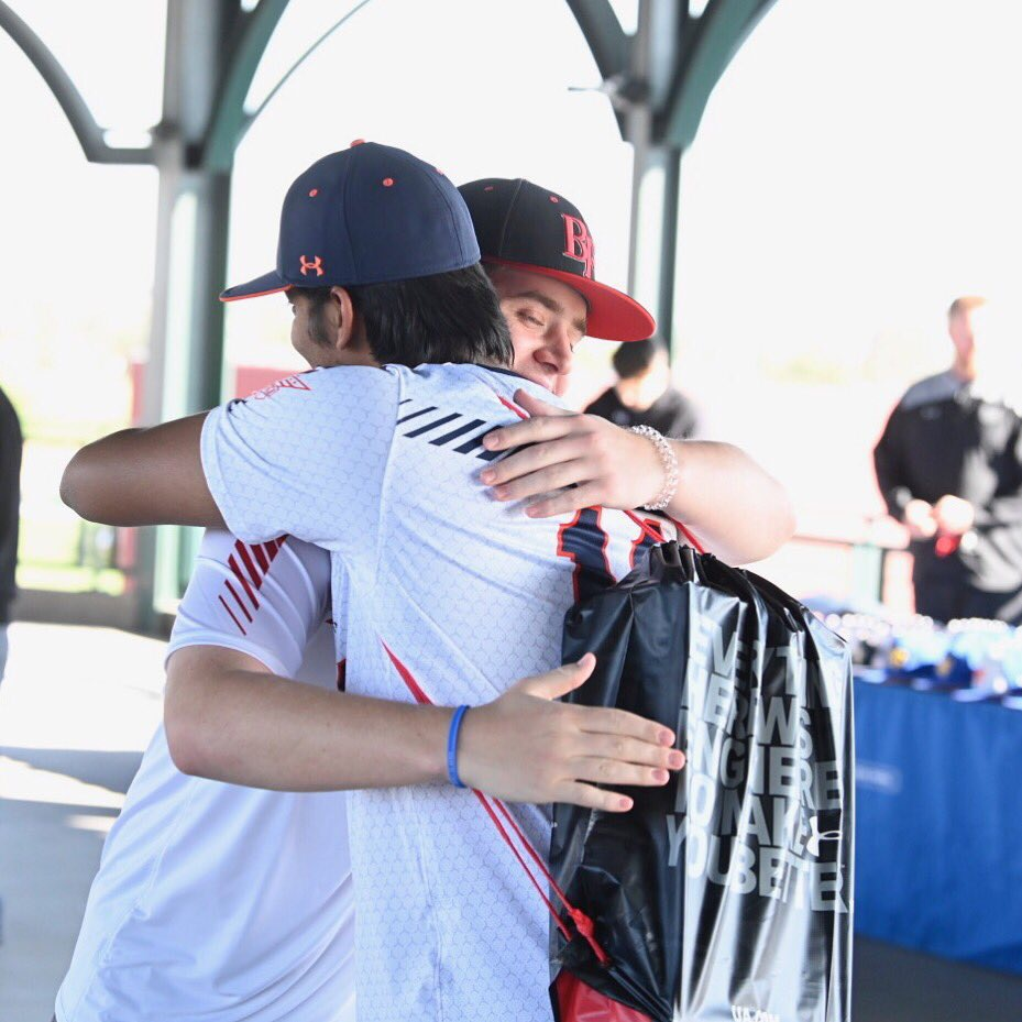 Friends embrace at All-America Pre-Season check-in (Photo courtesy: Matt Roth)